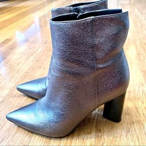 Metallic silver pointy toe boots